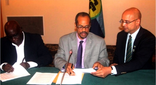 (l-r) Mr. Lindley Simeon Collins, CEO, CAHFSA; Mr. Milton Haughton, Executive Director, CRFM; and Mr. Deryck Omar, CEO, CROSQ sign MoU at Pegasus Hotel in Guyana